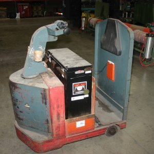 TMX Electric tow tractor with charger and battery. WS1992