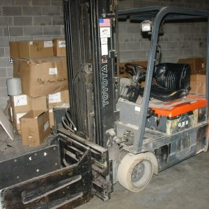 SOLD. Toyota 3000 lb electric squeeze truck with clamps. WS2437